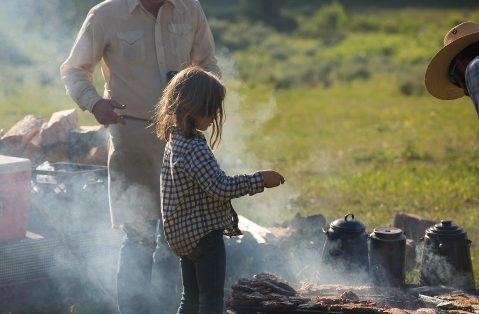 Cooking over the open fire on a Montana Dude Ranch