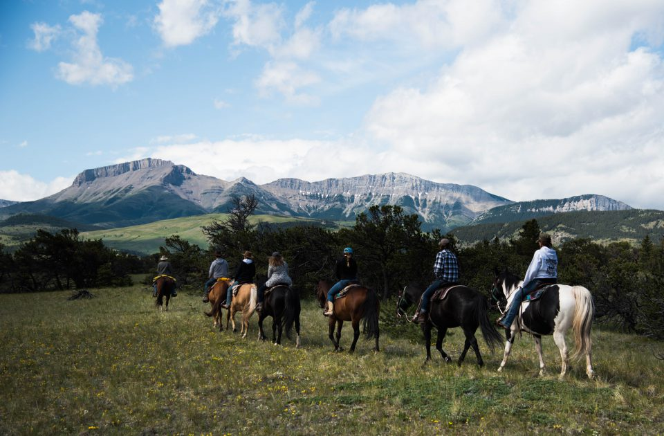 View of the rocky mountain front on horseback