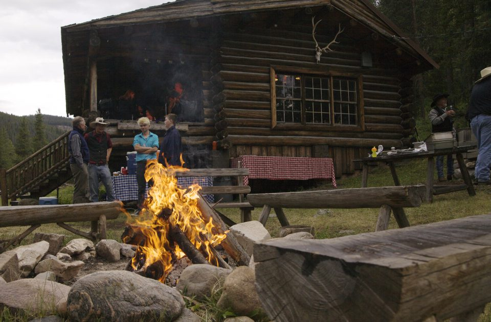 Warm up by the fire at Covered Wagon Ranch